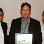 Stuart Jones (middle) accepts the Recycler of the Year Award (Large Entity) on behalf of InterfaceFlor