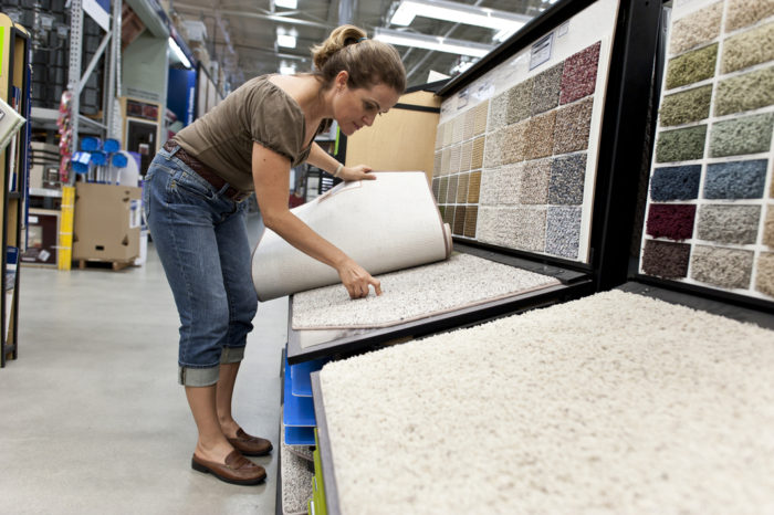 woman selecting carpet to buy